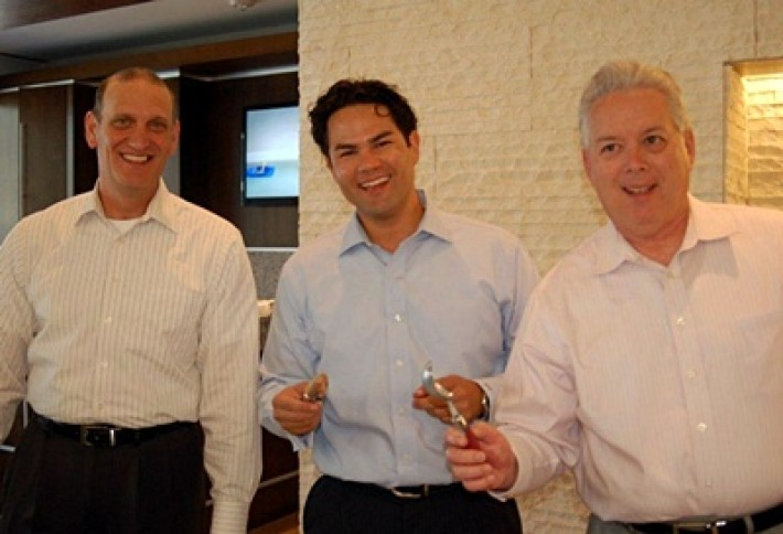 colliers Steve David Pinsel and Ralph Valliere serving ice cream